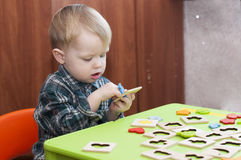 Centered child plays in the sorter Stock Images