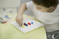 Activities for Kids. Simple Fine Motor Skills Activity for children. great way to teach a toddler or a preschooler to stock photography