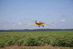 Centered Crop Dusting Plane Stock Photo
