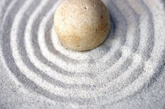 Centered zen pebble Royalty Free Stock Image