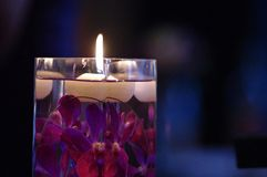 Centerpiece. A floating candle and purple flower centerpiece at a wedding Royalty Free Stock Photo