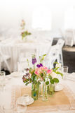 Centerpiece on a table. Centerpiece at a table for a tented event such as a wedding reception Stock Images