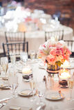 Centerpiece on a table. Floral centerpiece on a table at a wedding reception Stock Image