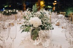 Centerpiece of white flowers at a wedding royalty free stock image