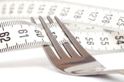 Centimeter and fork Royalty Free Stock Images