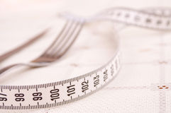 Centimeter, fork and knife Stock Photo