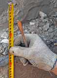 Centimeter in hands. construction work Stock Photo
