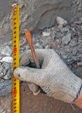 Centimeter in hands. construction work Stock Photo