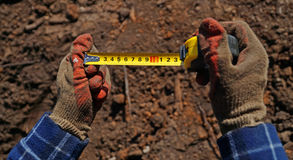 Centimeter in hands. construction work Royalty Free Stock Photo