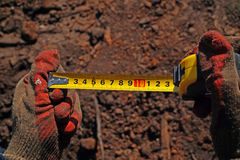 Centimeter in hands. construction work Stock Image
