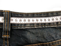 Centimeter on the jeans pants Stock Photo