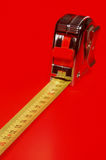 Centimeter meter with a red background Stock Images