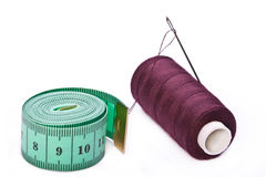 Centimeter and sewing spool Royalty Free Stock Images