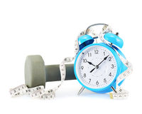 Centimeter tape, clock and dumbbell Stock Images