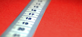 17 Centimeters. Blue and white measuring tape on a red background Stock Images