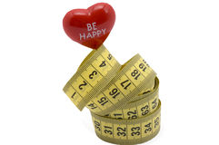 Centimeters of heart. Precision measure size of red heart by elastic centimeter Royalty Free Stock Photos