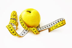 Centimetre round a yellow apple Royalty Free Stock Images