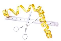Centimetre and scissors Stock Photo