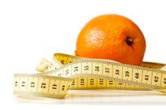centimetric橙色磁带 免版税库存图片