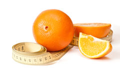 Centimetric tape and oranges Stock Image