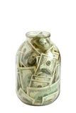 Centinaia di dollari farciti in un vaso di vetro Immagini Stock Libere da Diritti