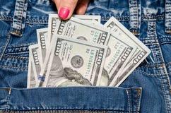 Cento banconote in dollari nella tasca Immagine Stock