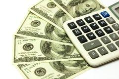 Cento banconote e calcolatori del dollaro Fotografie Stock Libere da Diritti
