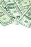 Cento dollari ed un dollaro di mucchio Immagini Stock