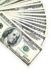 Cento dollari isolati su priorità bassa bianca Immagine Stock