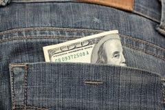Cento dollari nella tasca posteriore Fotografia Stock Libera da Diritti