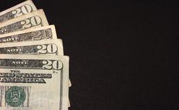 Cento dollari sul nero Fotografie Stock