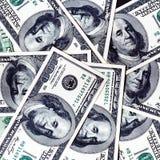 Cento priorità basse delle banconote del dollaro Fotografie Stock Libere da Diritti