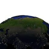 Centraal-Azië bij nacht op model van Aarde met in reliëf gemaakt land Stock Foto's