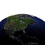 Centraal en Noord-Amerika bij nacht op model van Aarde met maakt in reliëf Stock Fotografie