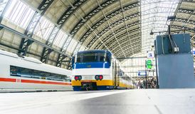 Centraal station roof architecture and peole on platform waiting. AMSTERDAM, HOLLAND - AUGUST 21, 2017; Centraal station roof architecture and peole on platform Royalty Free Stock Photography