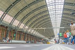 Centraal station roof architecture and peole on platform waiting. AMSTERDAM, HOLLAND - AUGUST 21, 2017; Centraal station roof architecture and peole on platform Stock Images