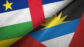Central African Republic and Antigua and Barbuda two flags textile cloth. Central African Republic and Antigua and Barbuda two folded flags together royalty free stock photography