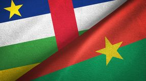 Central African Republic and Burkina Faso two flags textile cloth. Central African Republic and Burkina Faso two folded flags together stock photo
