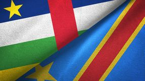 Central African Republic and Congo Democratic Republic two flags textile cloth. Central African Republic and Congo Democratic Republic two folded flags together royalty free stock photography