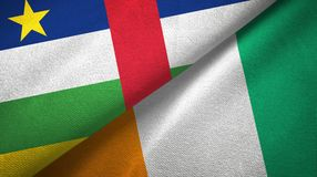 Central African Republic and Cote d`Ivoire Ivory coast two flags textile. Central African Republic and Cote d`Ivoire Ivory coast two folded flags together royalty free stock photo