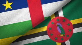 Central African Republic and Dominica two flags textile cloth, fabric texture. Central African Republic and Dominica two folded flags together royalty free stock images