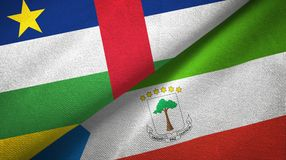 Central African Republic and Equatorial Guinea two flags textile cloth. Central African Republic and Equatorial Guinea two folded flags together royalty free stock image