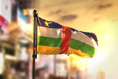 Central African Republic Flag Against City Blurred Background At stock photos