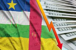 Central African Republic flag and chart falling US dollar position with a fan of dollar bills royalty free stock photos