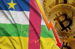 Central African Republic flag and cryptocurrency falling trend with many golden bitcoins royalty free stock image