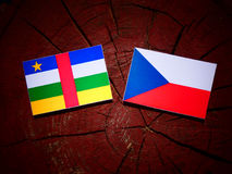 Central African Republic flag with Czech flag on a tree stump is Royalty Free Stock Photos