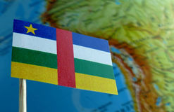 Central African Republic flag with a globe map as a background Royalty Free Stock Image