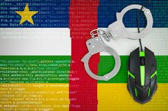 Central African Republic flag and handcuffed computer mouse. Combating computer crime, hackers and piracy royalty free stock images