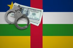 Central African Republic flag with handcuffs and a bundle of dollars. The concept of breaking the law and thieves crimes stock images