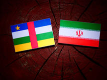 Central African Republic flag with Iranian flag on a tree stump. Isolated Royalty Free Stock Image